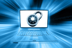 Laptop computer, padlock and codes